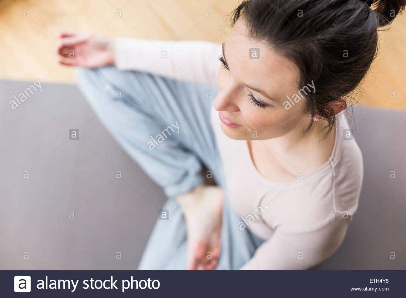 Mid adult woman meditating - Stock Image