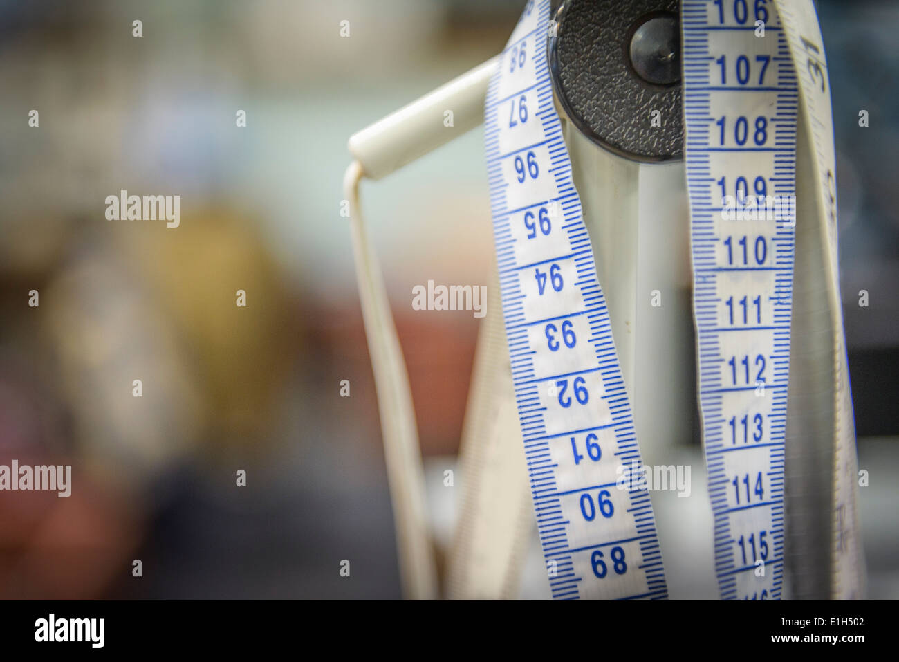Tape measure in clothing factory, close up - Stock Image