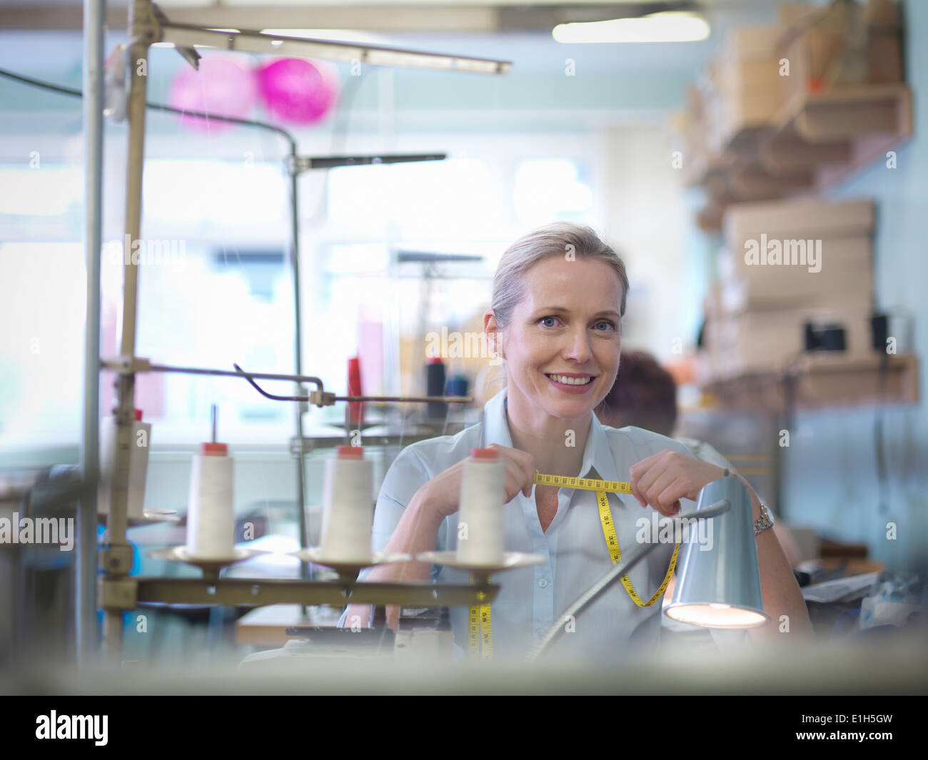 Portrait of worker in clothing factory - Stock Image