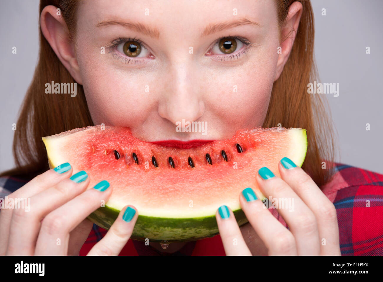 Young woman with slice of watermelon - Stock Image