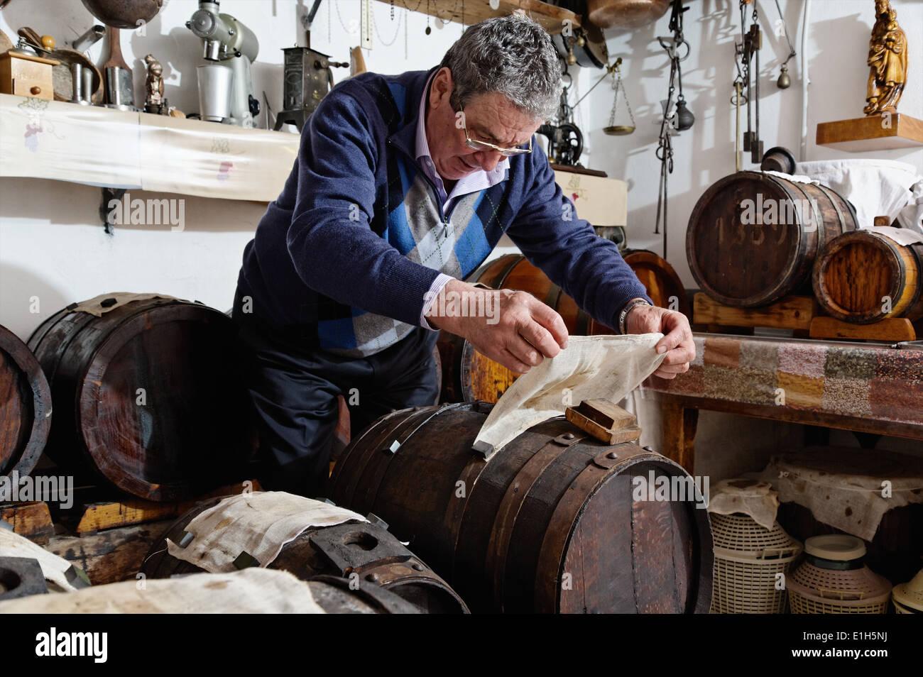 Man making and taking care over Aceto Balsamico Tradizionale di Modena - Stock Image