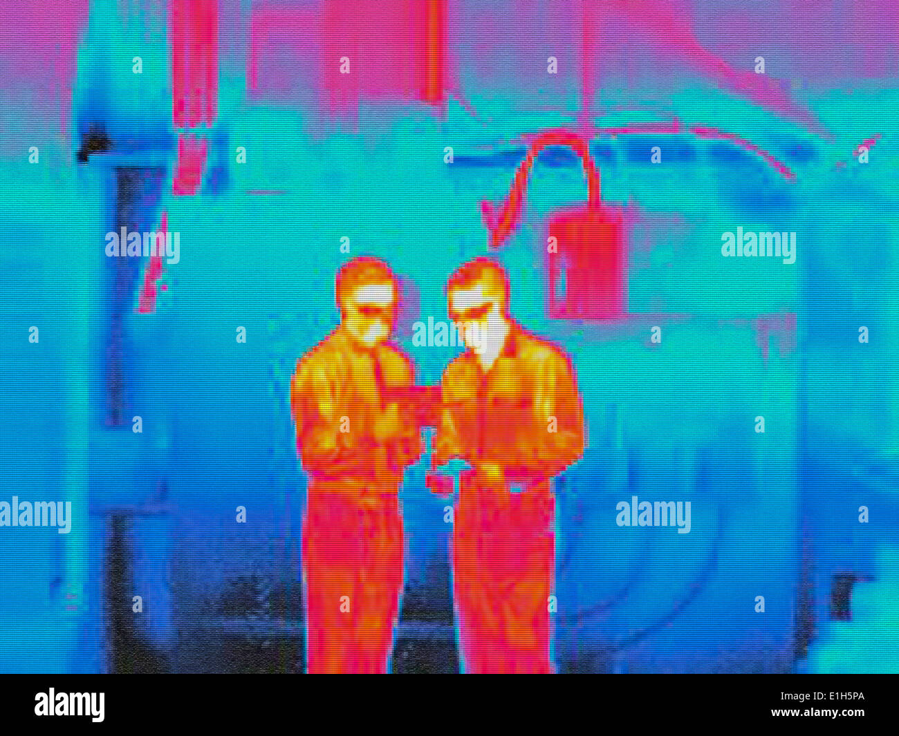 Infra red heat image of factory workers - Stock Image