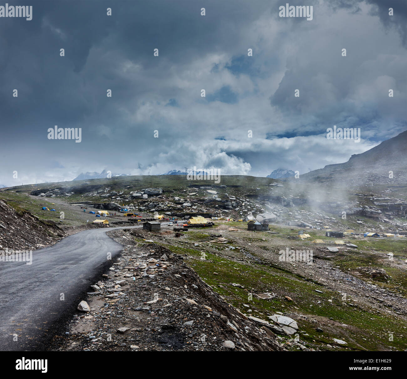 Road in Himalayas on top of Rohtang La pass, Himachal Pradesh, India - Stock Image