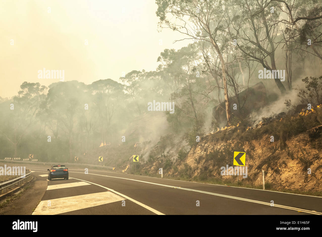 Bush fire and highway, New South Wales, Australia - Stock Image