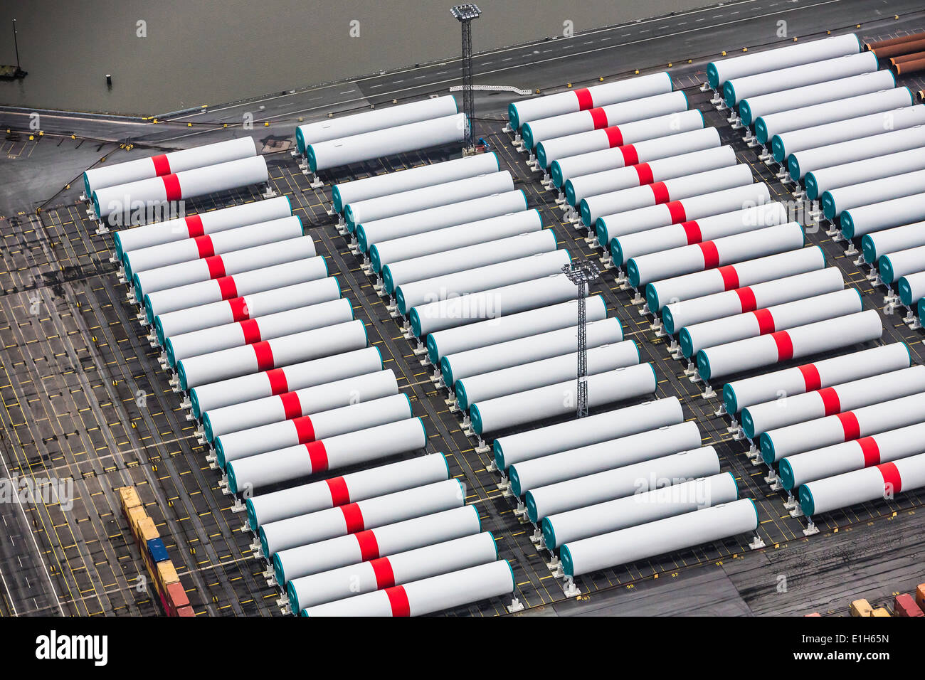 Rows of wind towers, component part for off shore wind turbines, Bremerhaven, Bremen, Germany - Stock Image