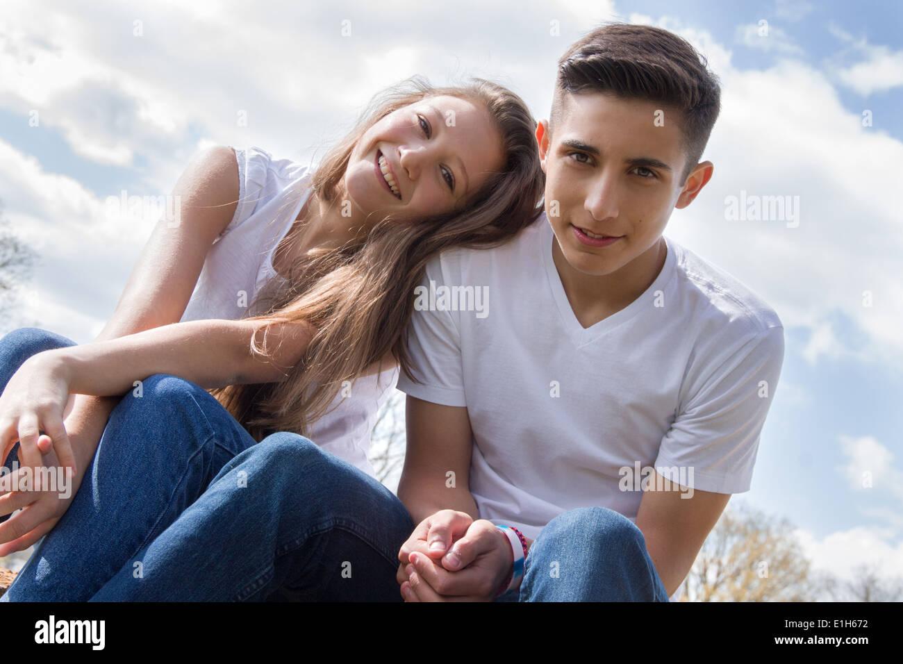 Angled portrait of teenage couple - Stock Image
