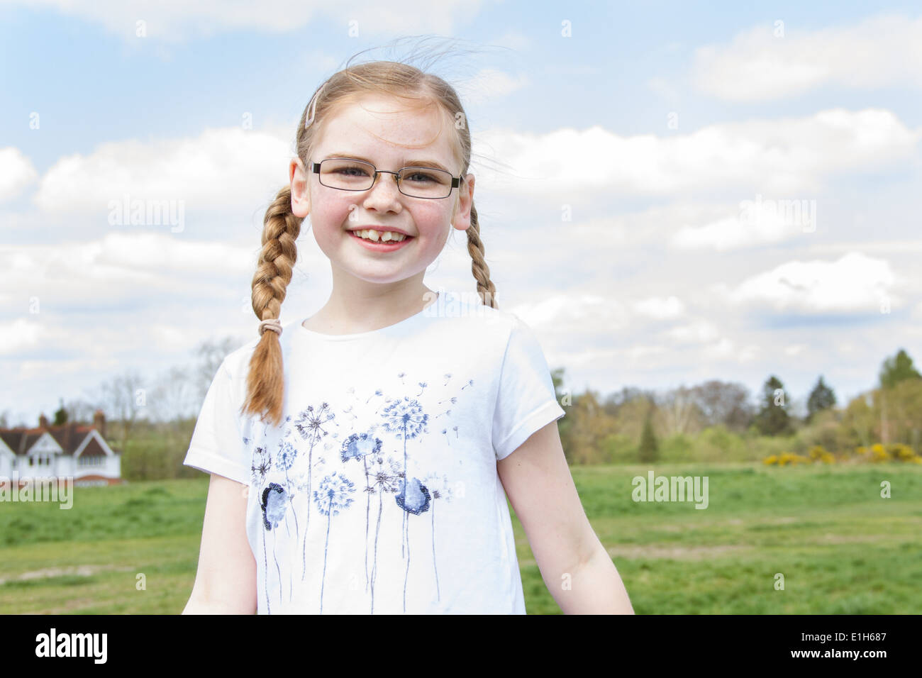 Portrait of girl with blond plaits - Stock Image