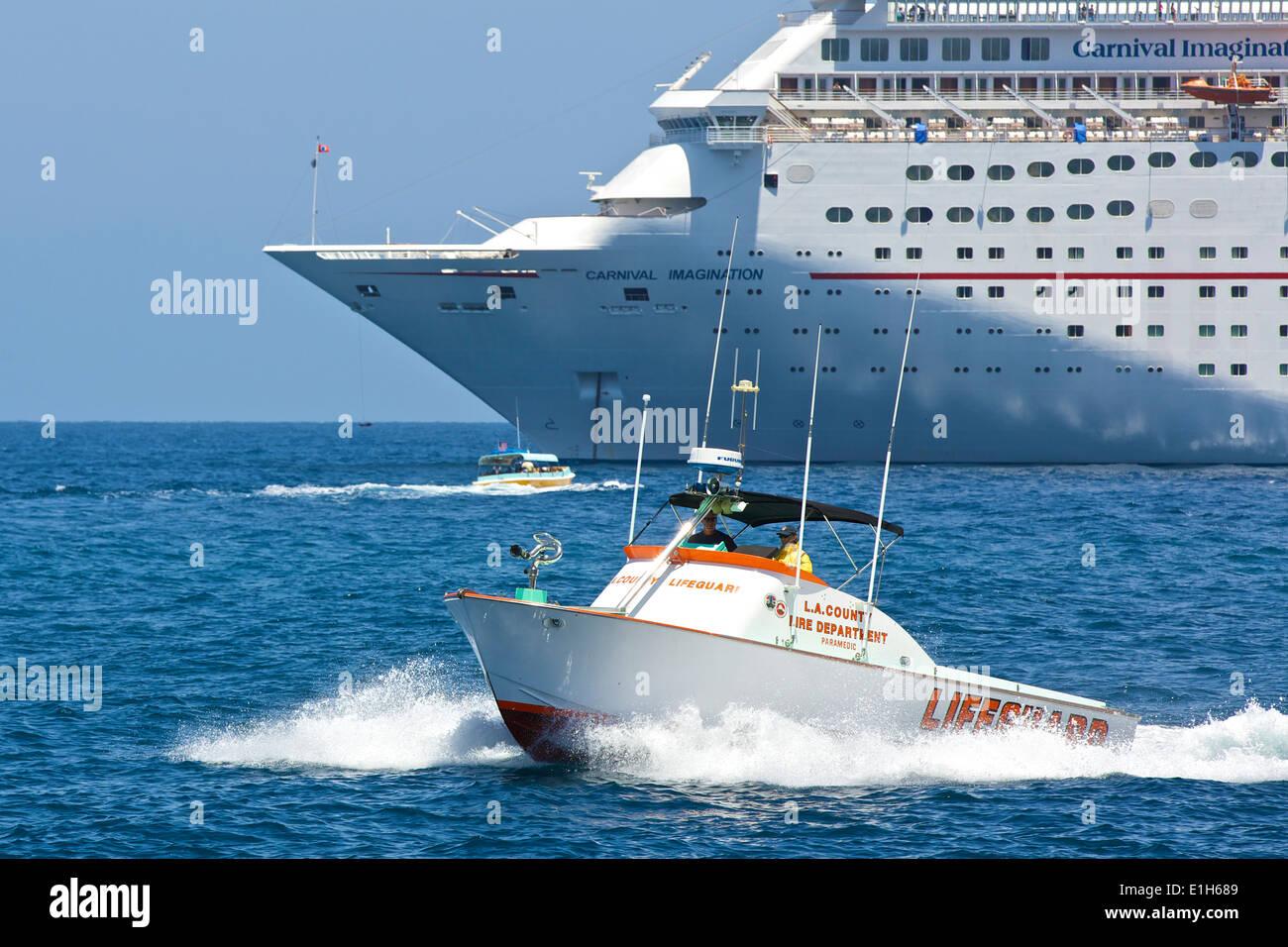 4df4de99e1aa LA County Fire Department Lifeguard Rescue Boat Speeds Past The Carnival  Inspiration Cruise Ship