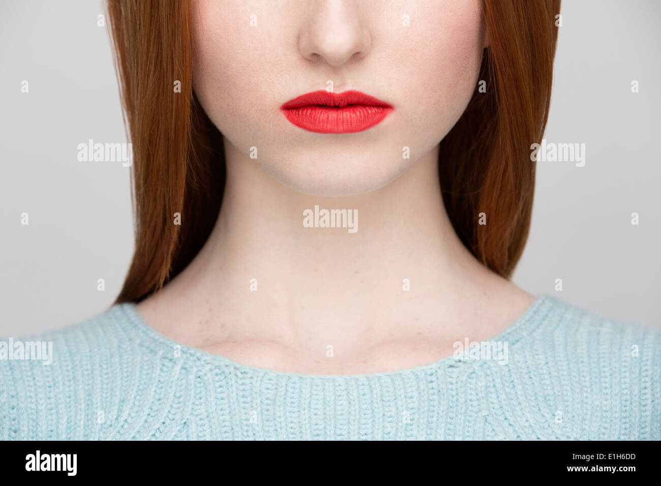 Cropped image of young woman's lips - Stock Image
