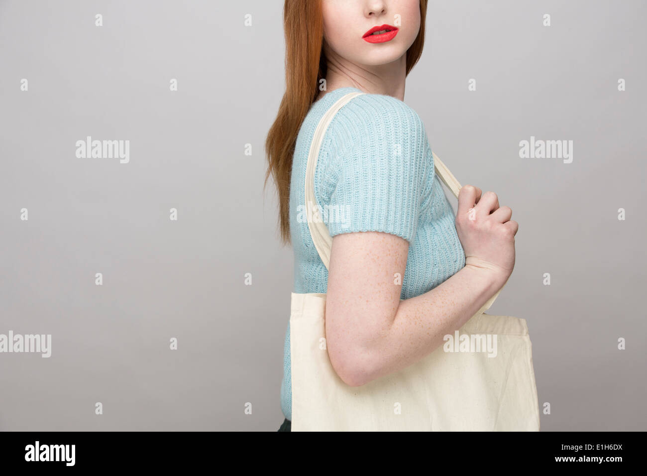Cropped image of young woman carrying shopping bag Stock Photo