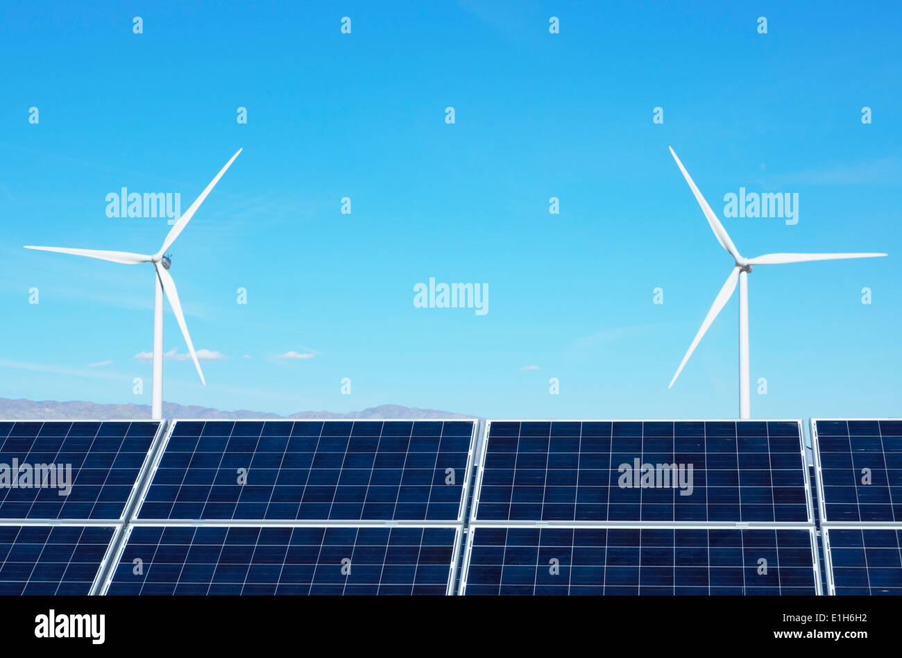 Photovoltaic solar panels and wind turbines, San Gorgonio Pass Wind Farm, Palm Springs, California, USA - Stock Image