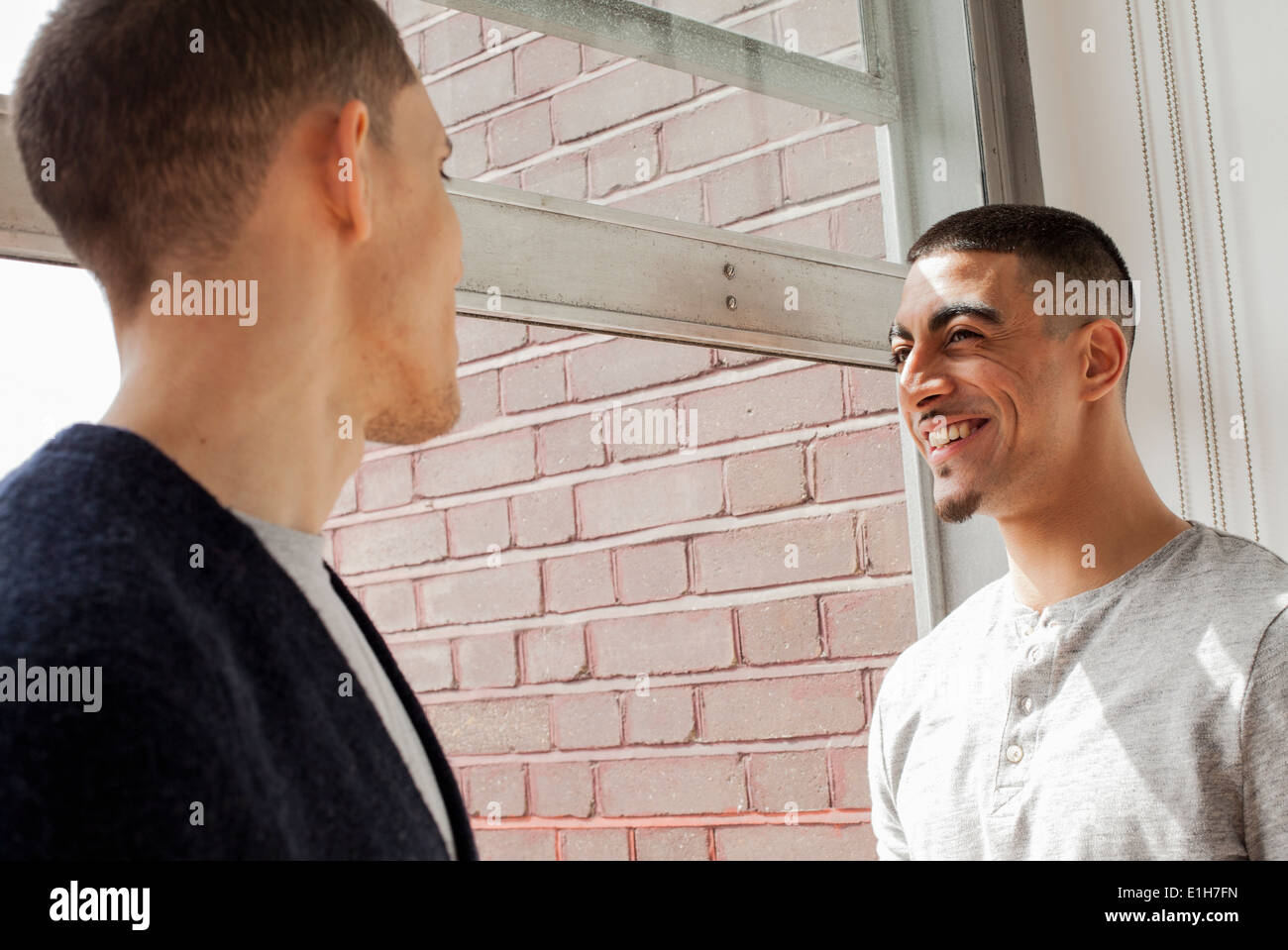 Young men having conversation - Stock Image