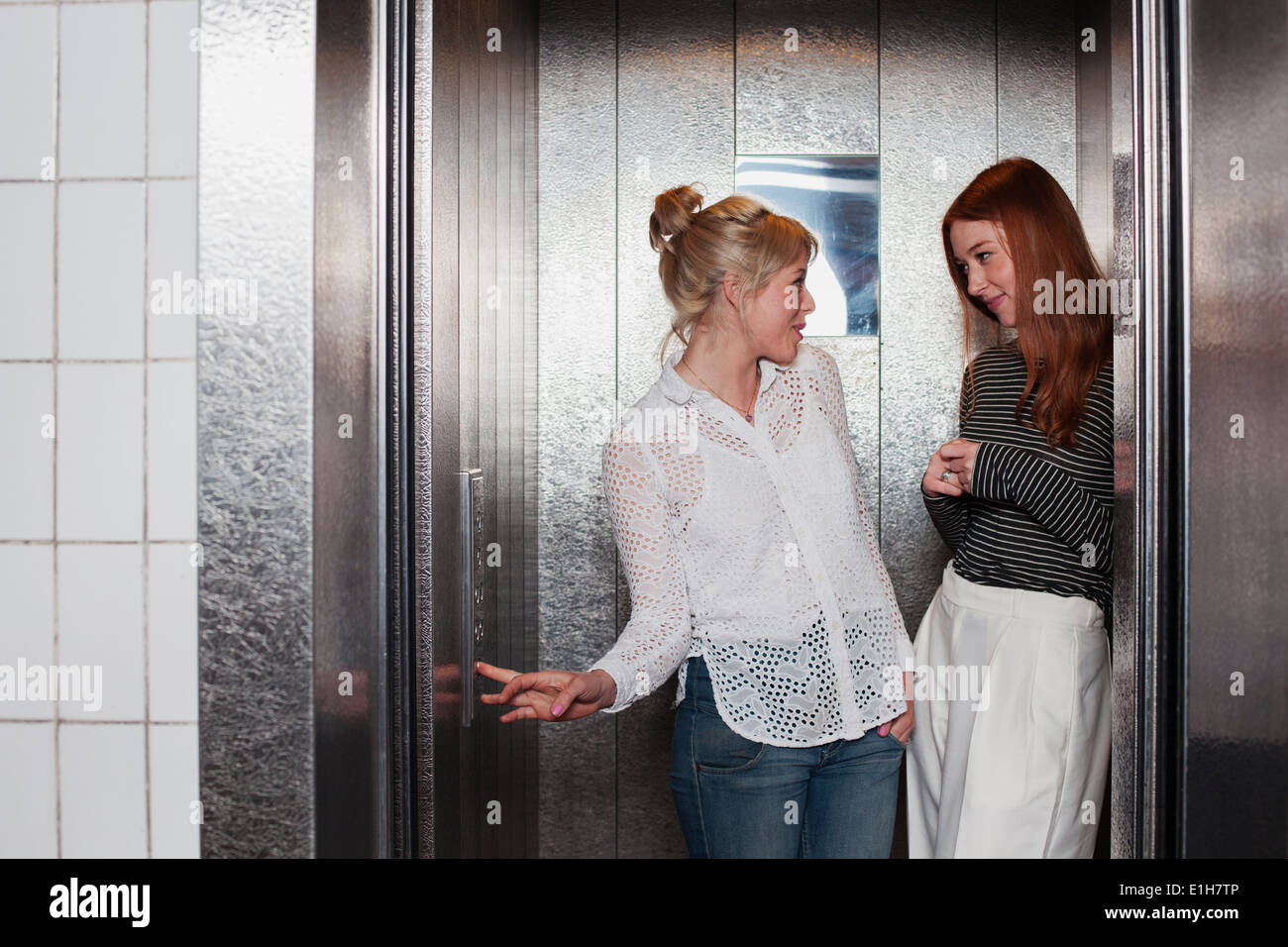 Young women in lift - Stock Image