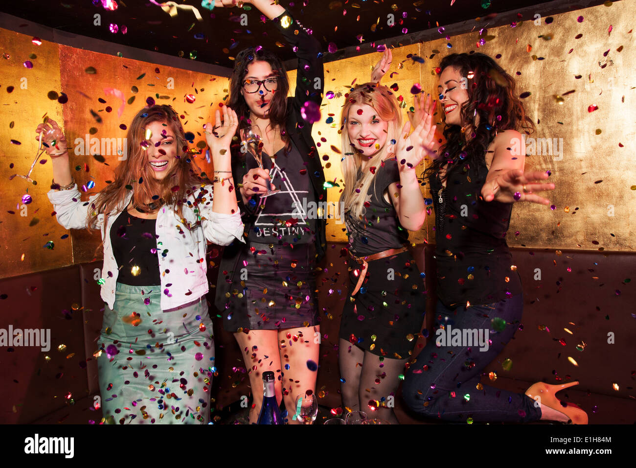 Four female friends partying in nightclub - Stock Image