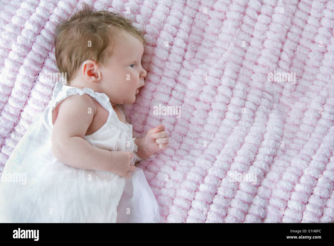Baby girl lying on side stock image