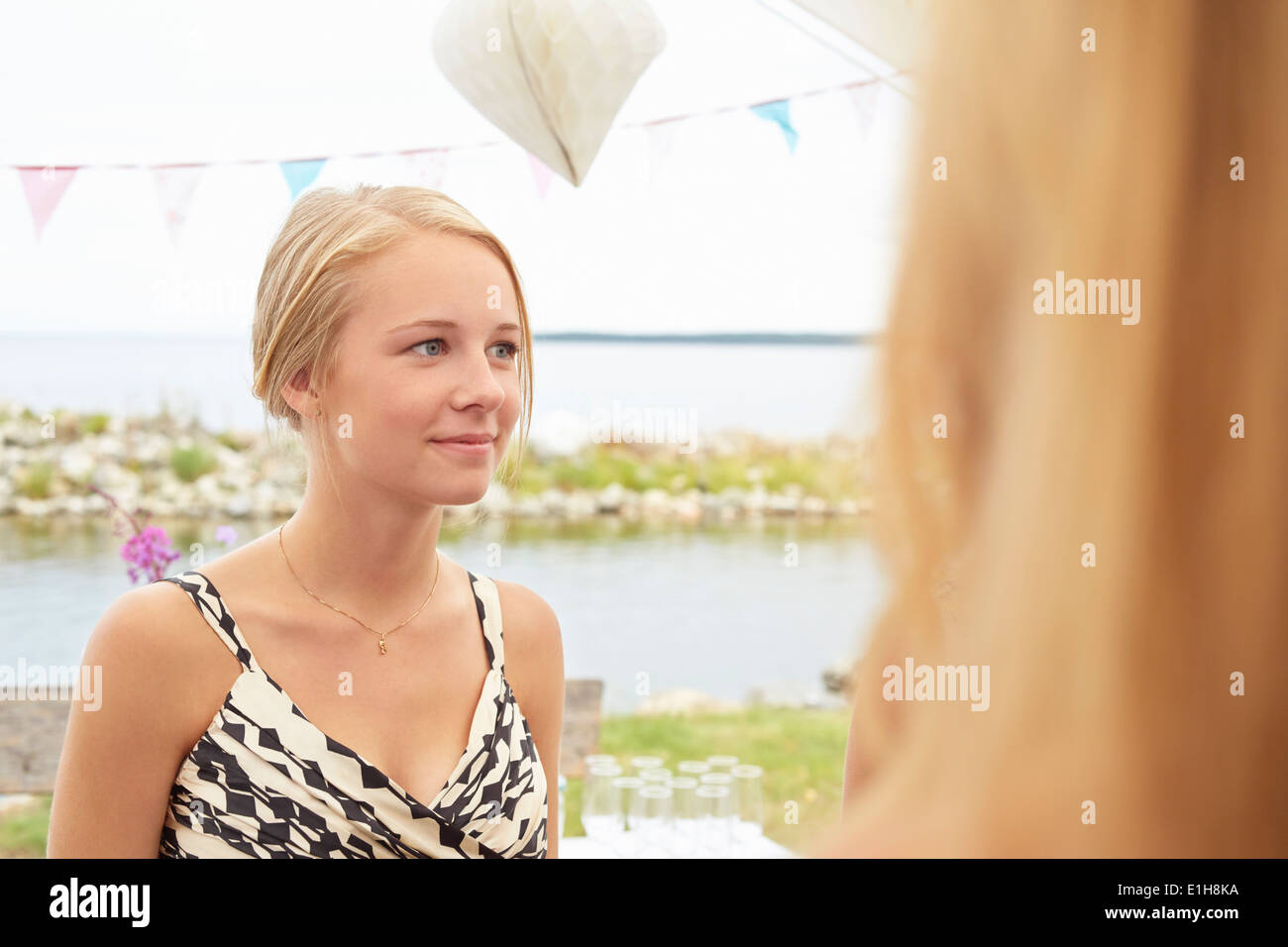 Two young female guests at wedding reception Stock Photo