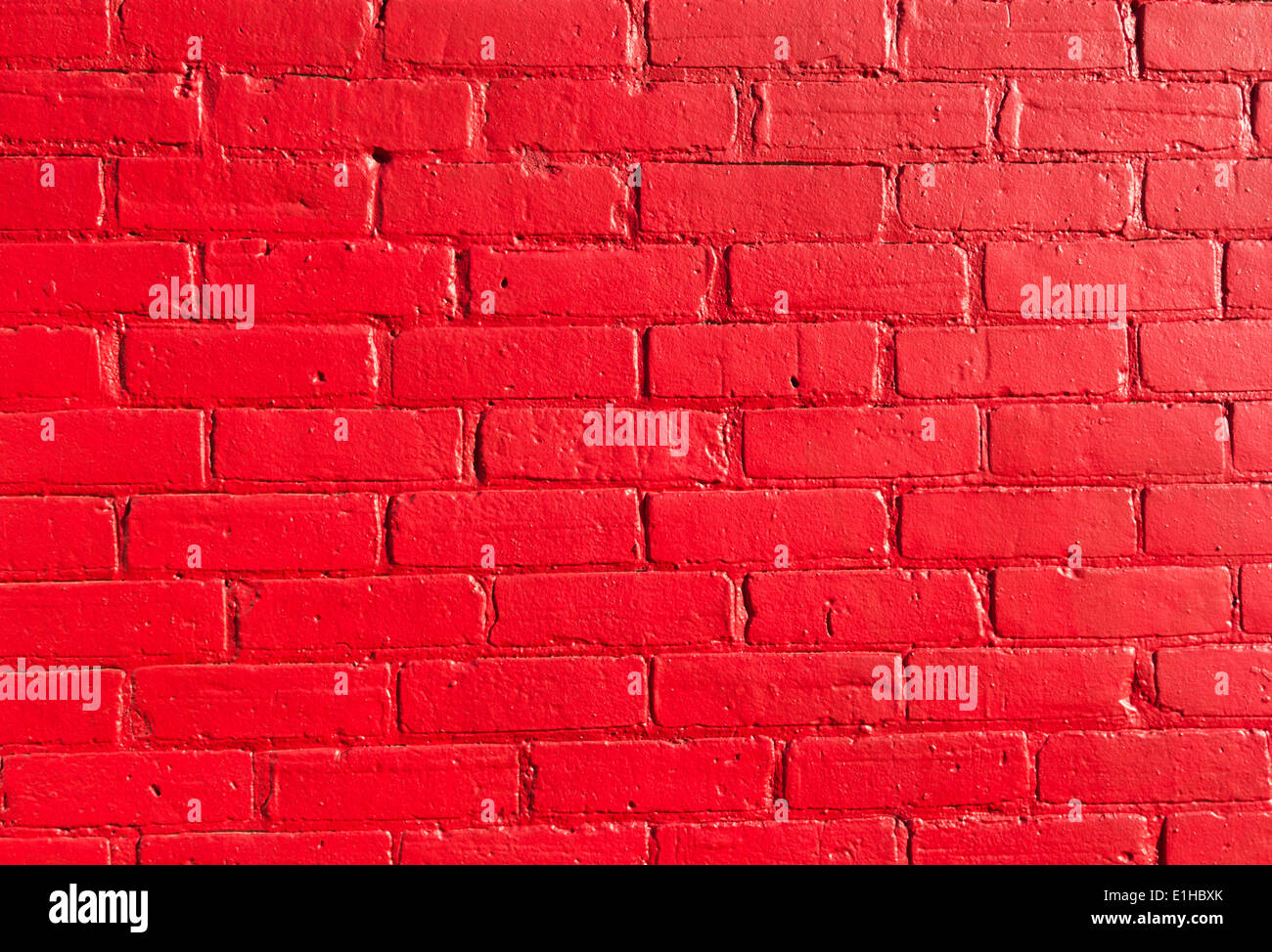 Closeup to Bright red Bricks on a wall - Stock Image