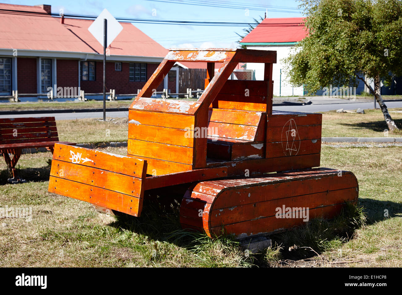 wooden bulldozer in a childrens play area with grafitti star of david scraped onto the side Punta Arenas Chile - Stock Image