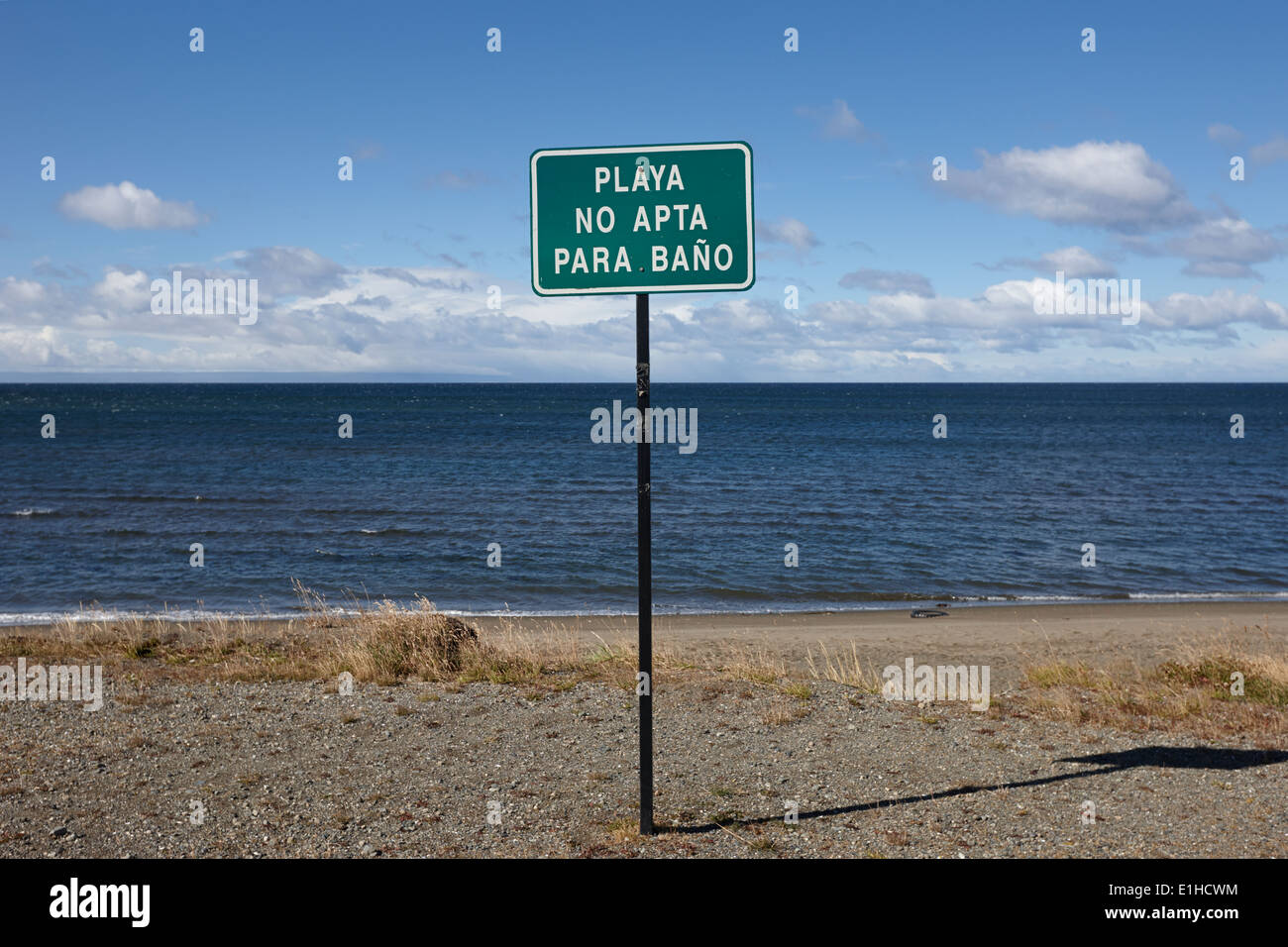 playa no apta para bano unsuitable for swimming strait of magellan coastal shoreline in Punta Arenas Chile - Stock Image