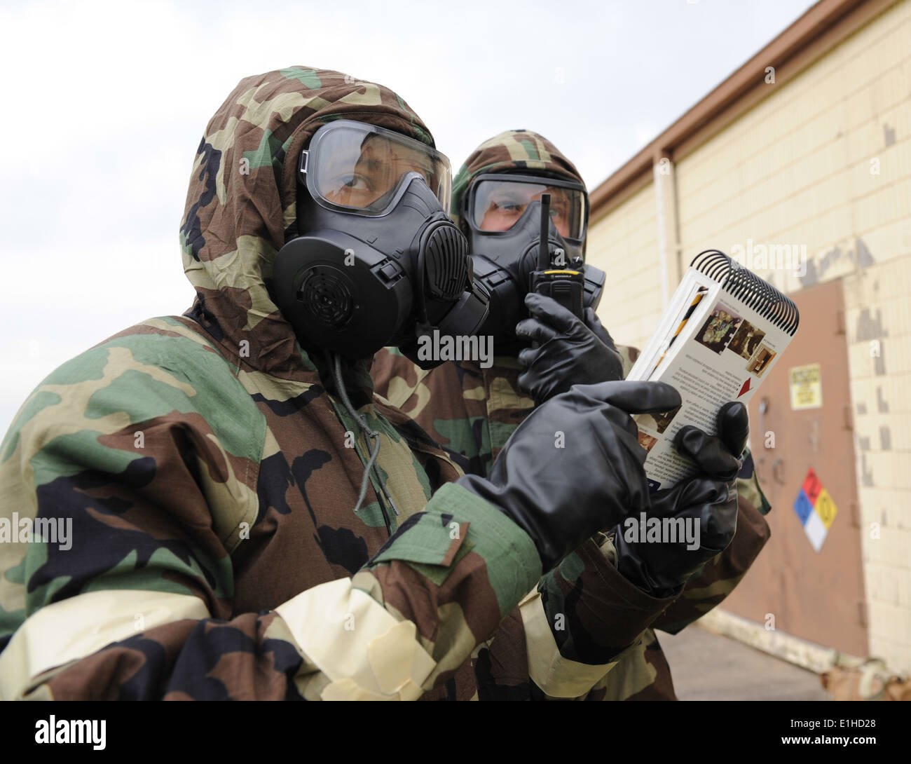 U.S. Airmen refer to the Airman's Manual during the Ability to Survive and Operate (ATSO) exercise at Barksdale Air Force Base, - Stock Image