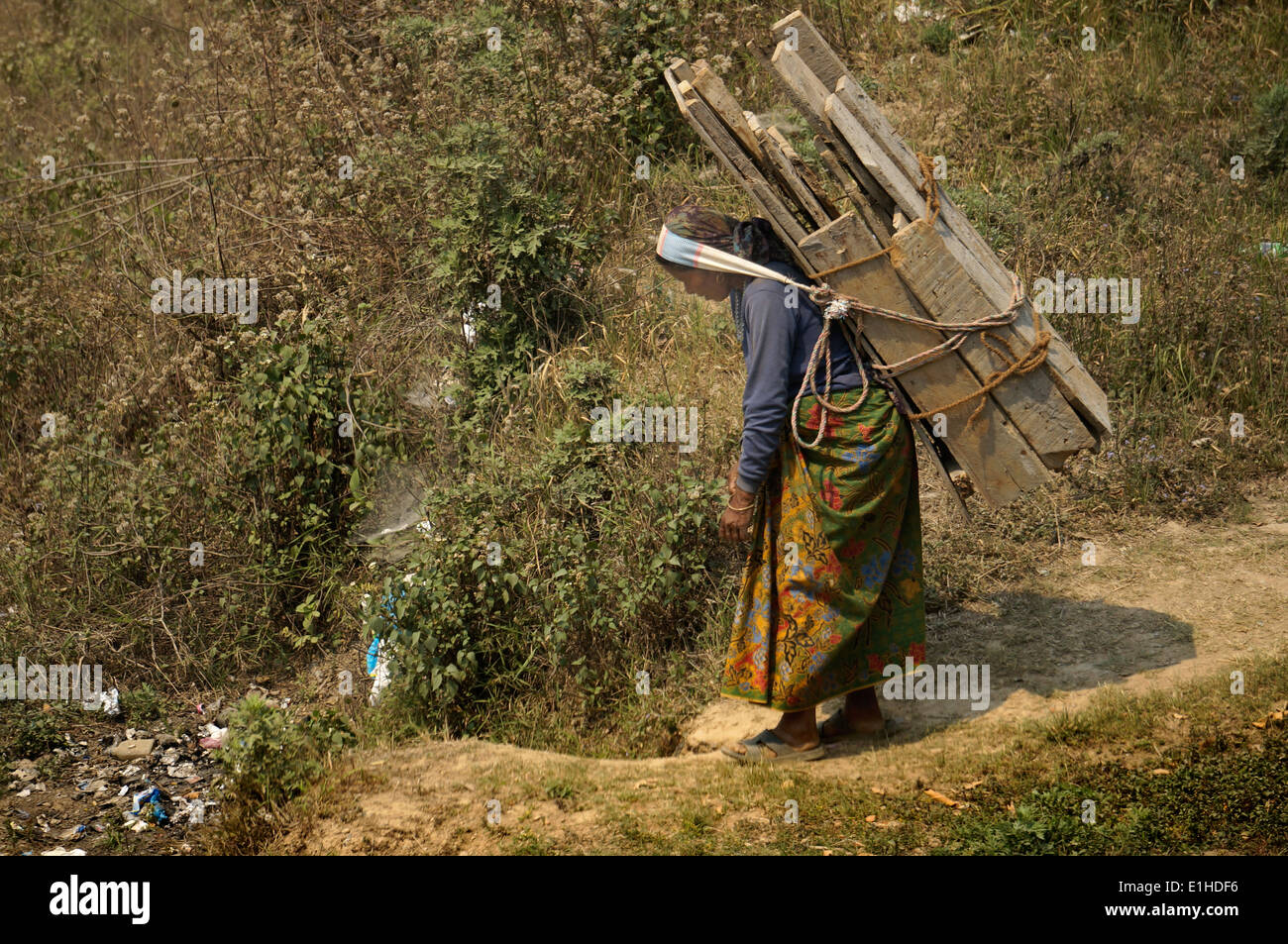 Lady caring heavy load - Stock Image