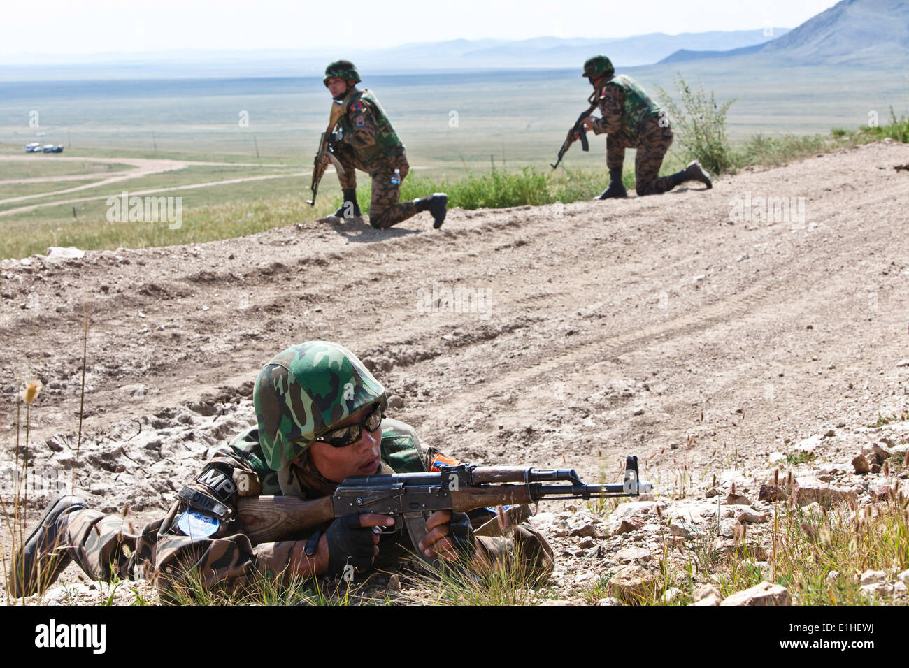 Mongolian soldiers from unit 032 military police, detain the area during a patrol at Five Hills Training area during Khaan Ques - Stock Image