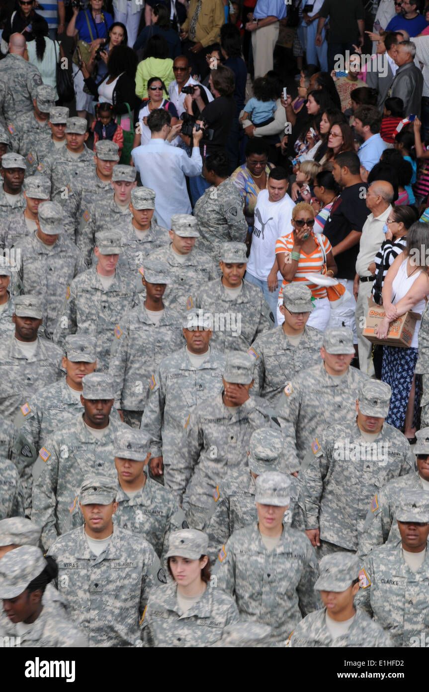U.S. Soldiers with the 101st Expeditionary Signal Battalion, New York Army National Guard march out of a hangar Stock Photo