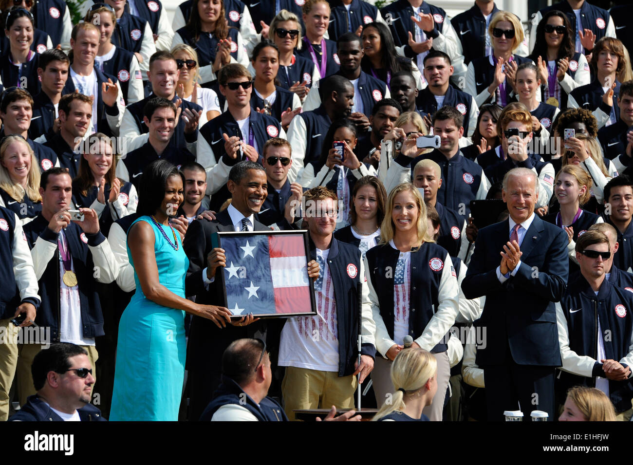 From left to right, first lady Michelle Obama, President Barack Obama, Paralympic swimmer Brad Snyder, Olympic fencer Stock Photo