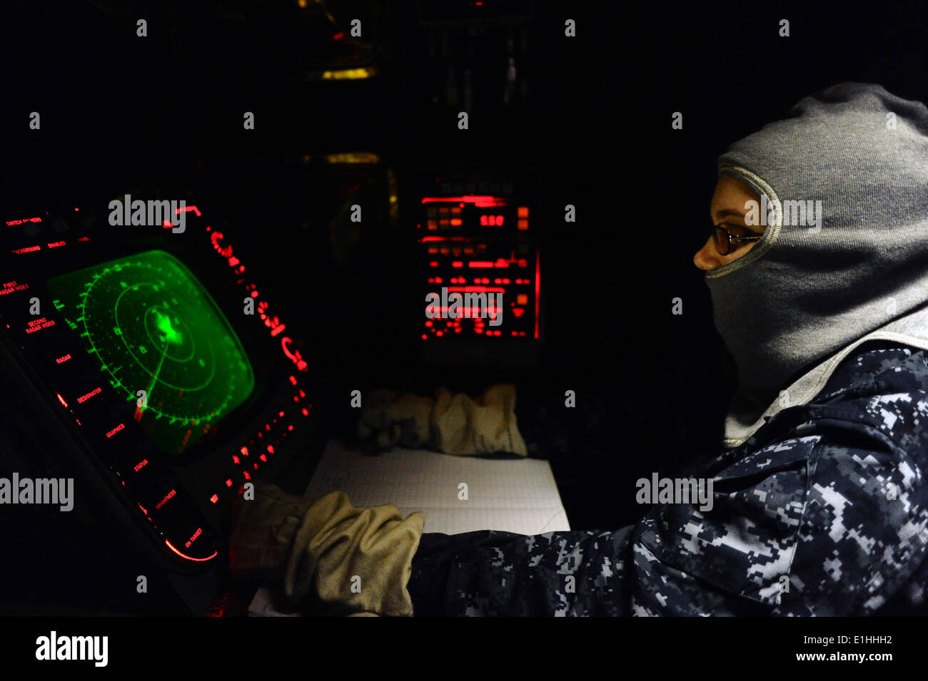 us navy operations specialist seaman rachel brown operates the spa 25 radar tracking system during a general quarters drill a