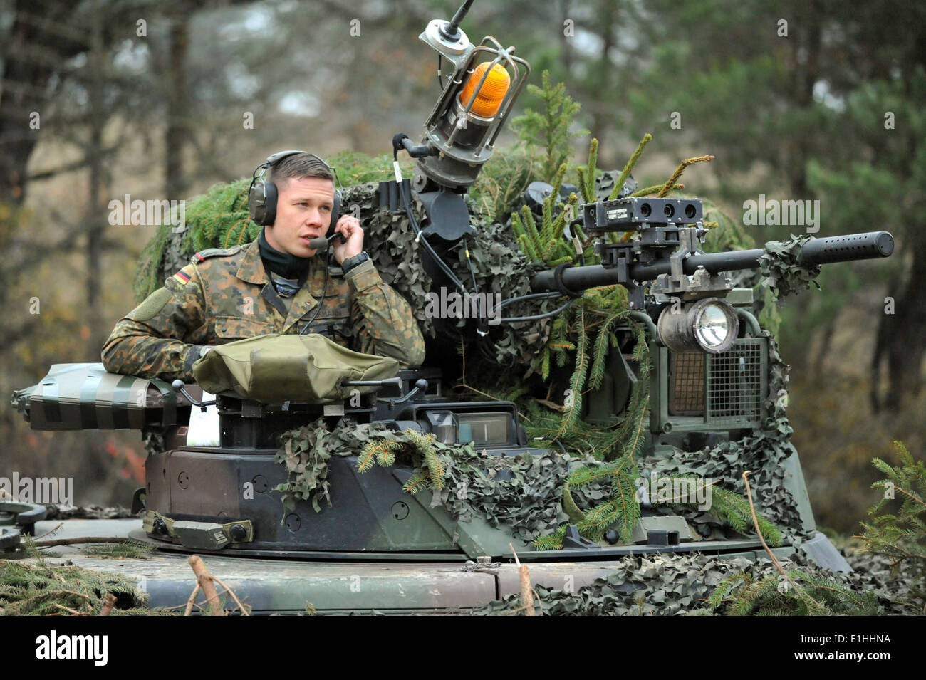 A German Army Soldiers in a Marder infantry fighting vehicle scans the battlefield during Saber Junction 2012 at the Joint Mult - Stock Image