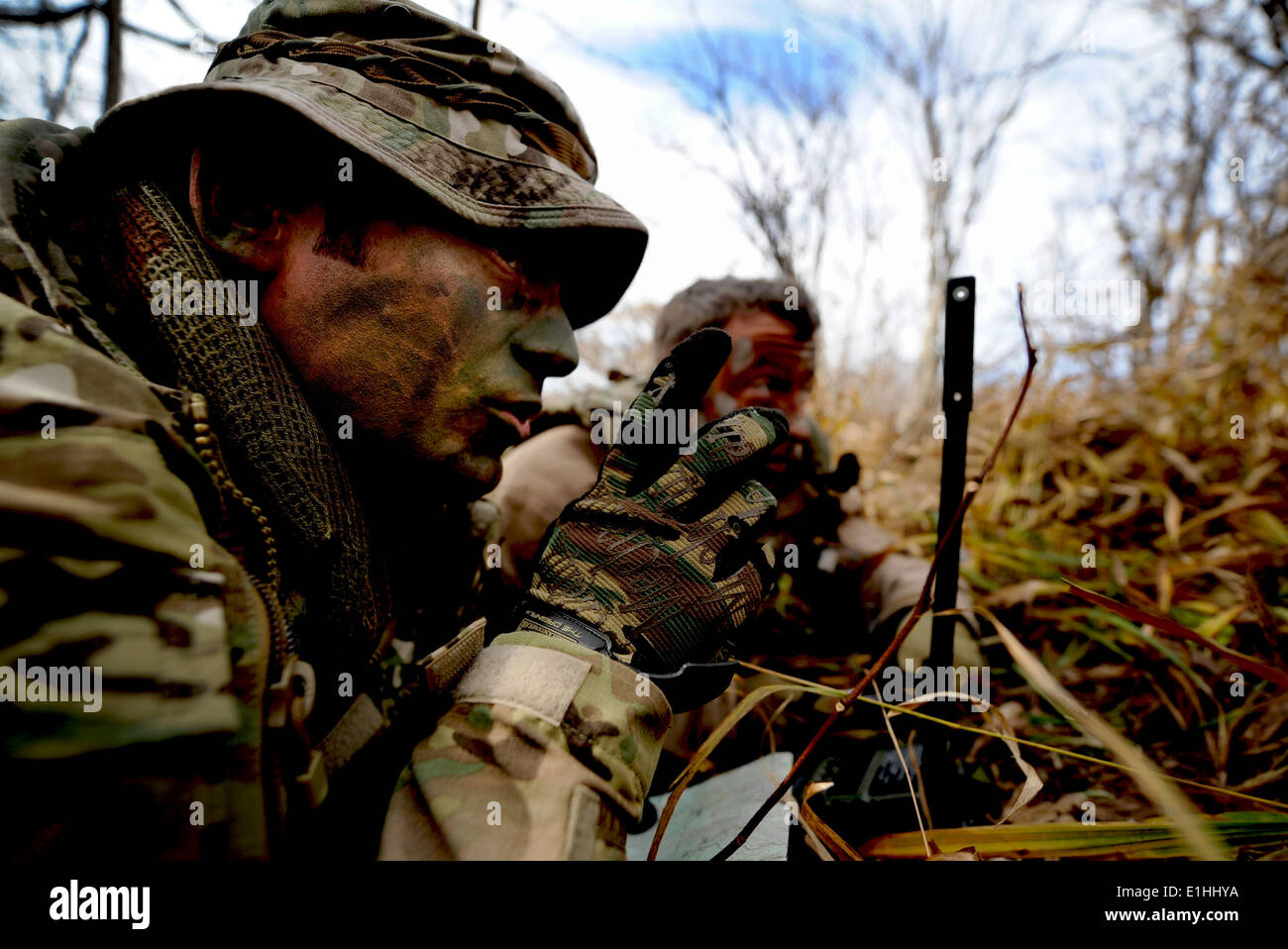 U.S. Air Force Tech. Sgt. Bobby Colliton and Staff Sgt. Dane Hatley conduct combat survival training near Osan Air Stock Photo