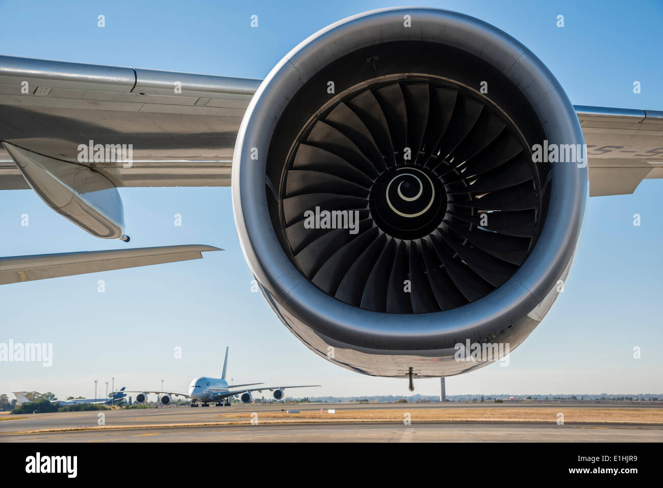 Jet engine, Airbus A340 turbine, an Airbus A380 on a runway at the back, South Africa - Stock Image