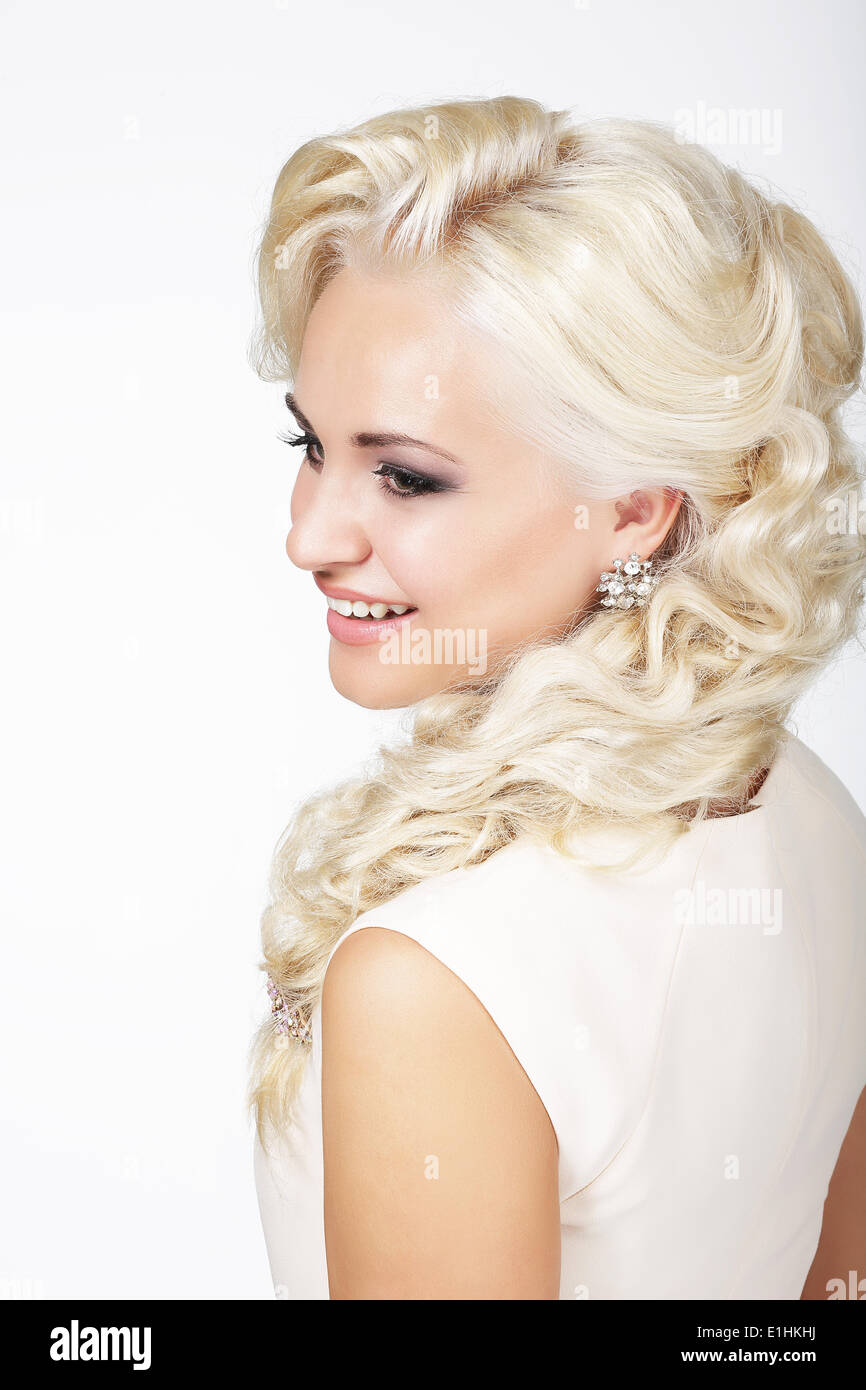 Portrait of Smiling Fashionable Blond Hair Woman with Plait - Stock Image