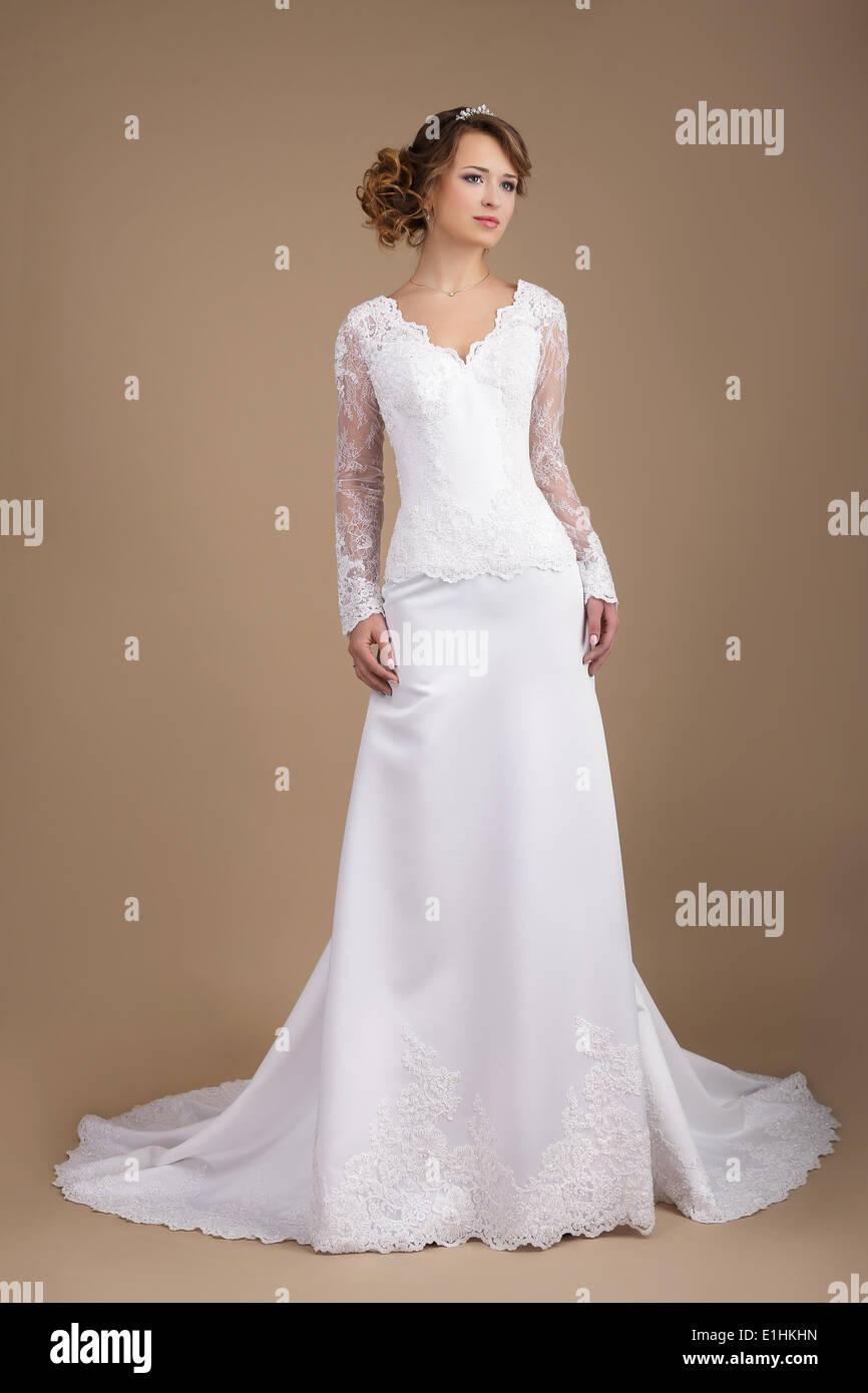Graceful Exquisite Auburn Bride in Wedding Dress - Stock Image