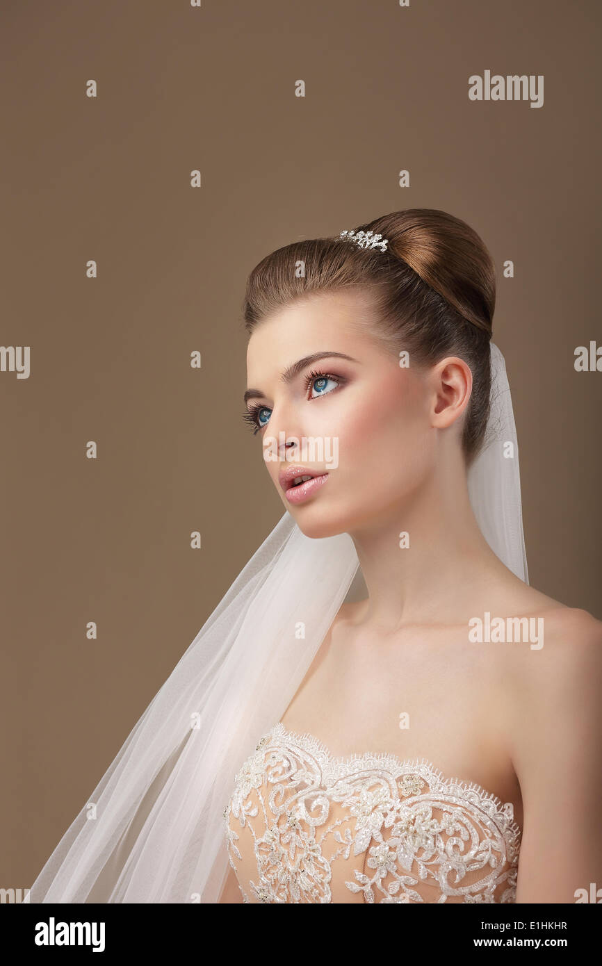 Classy Elegant Woman with Veil Looking Up - Stock Image