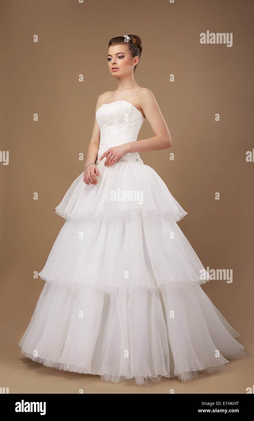 Elegance. Young Lady in Long Classic Bridal Dress - Stock Image