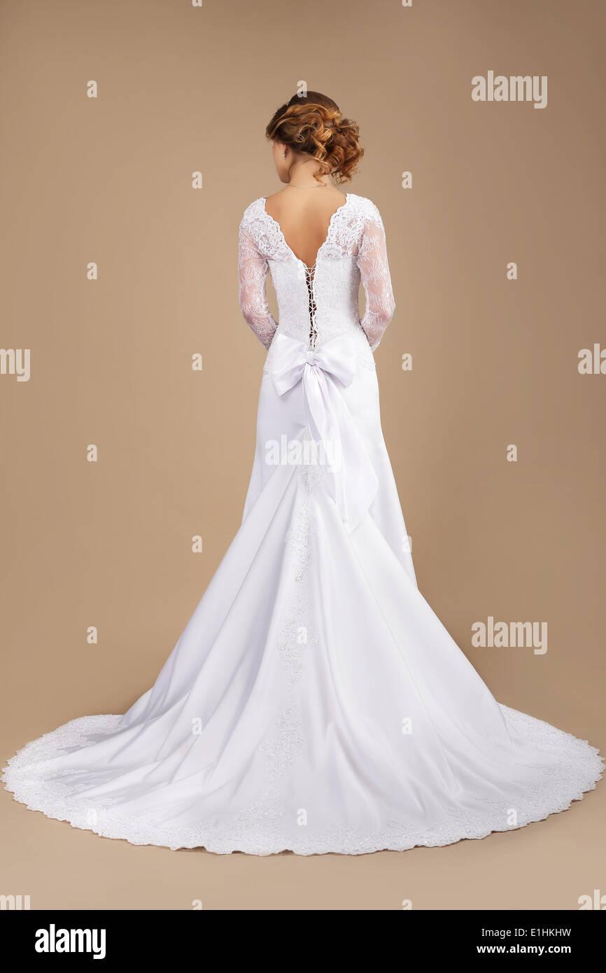 Holiday. Rear View of Auburn Woman in Long Festive Dress Stock Photo