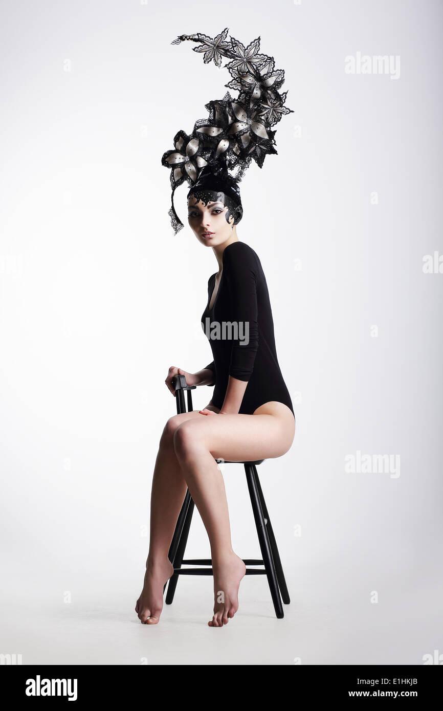 Artistic Fancy Woman wearing Extraordinary Fancy Headdress Stock Photo