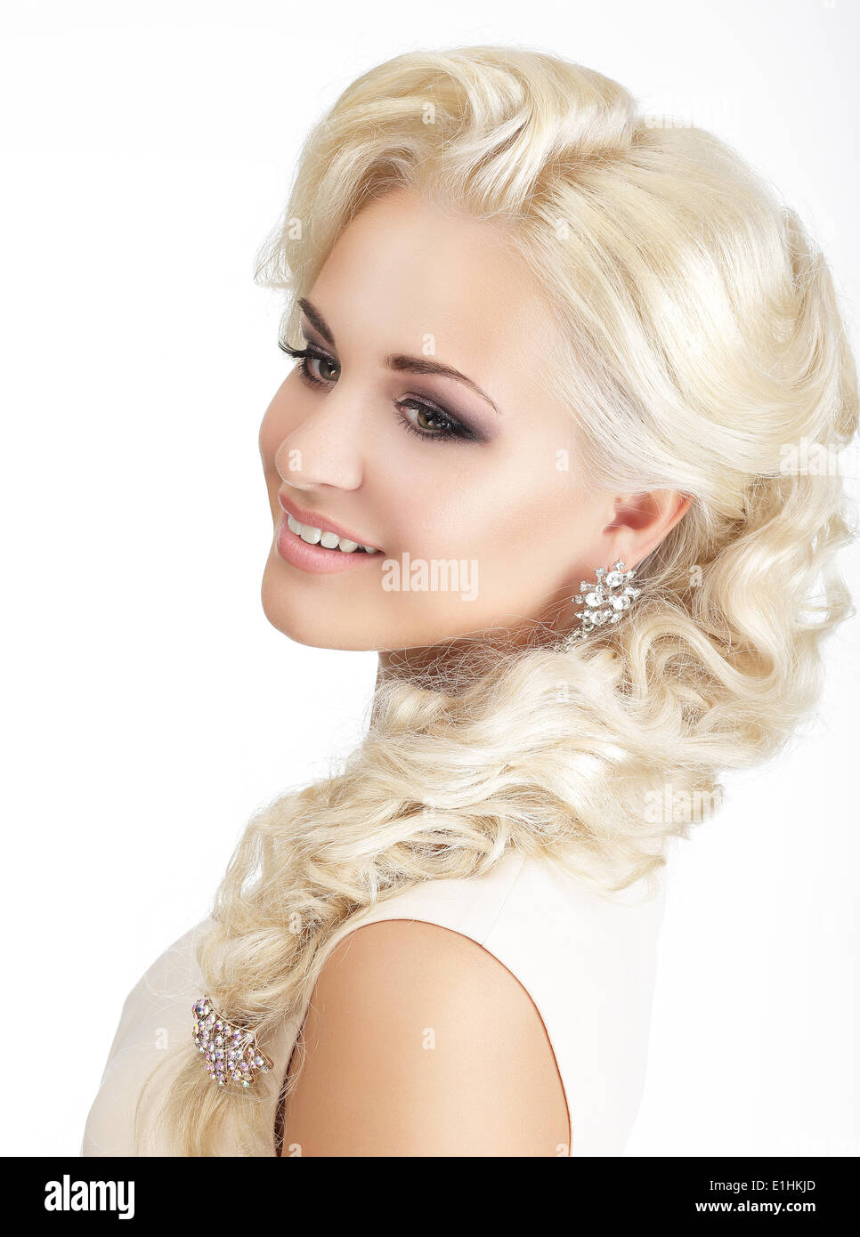Portrait of Delighted Smiling Blonde with Tress and Jewelry - Stock Image