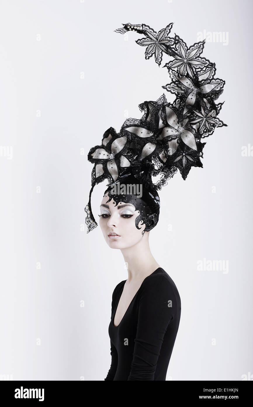 Creative Concept. Portrait of Futuristic Woman in Art Fabulous Headdress - Stock Image