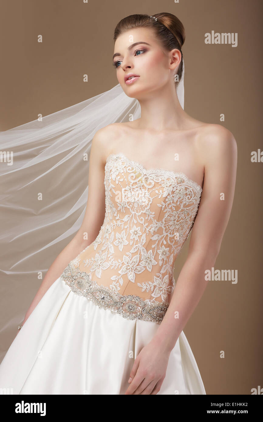 Elegance. Young Stylish Slender Woman in Golden Corset - Stock Image