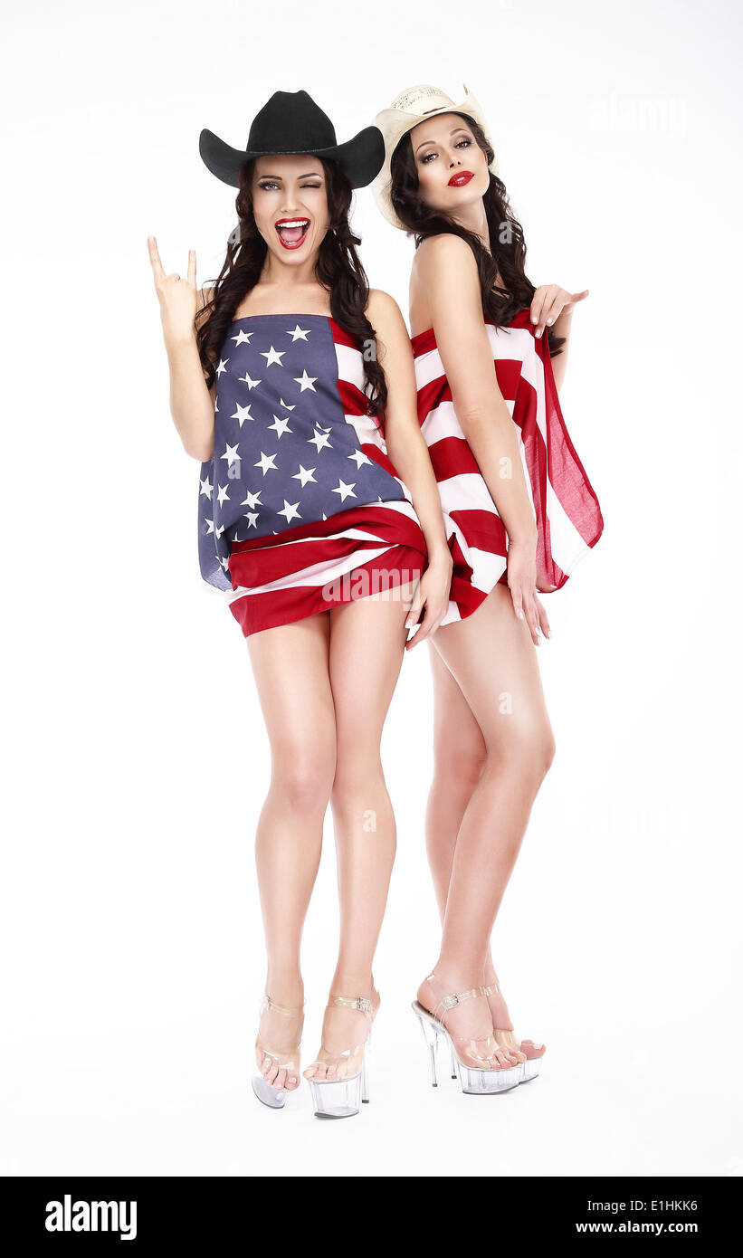 Glamorous Lucky Females in Hats and American Flag posing - Stock Image