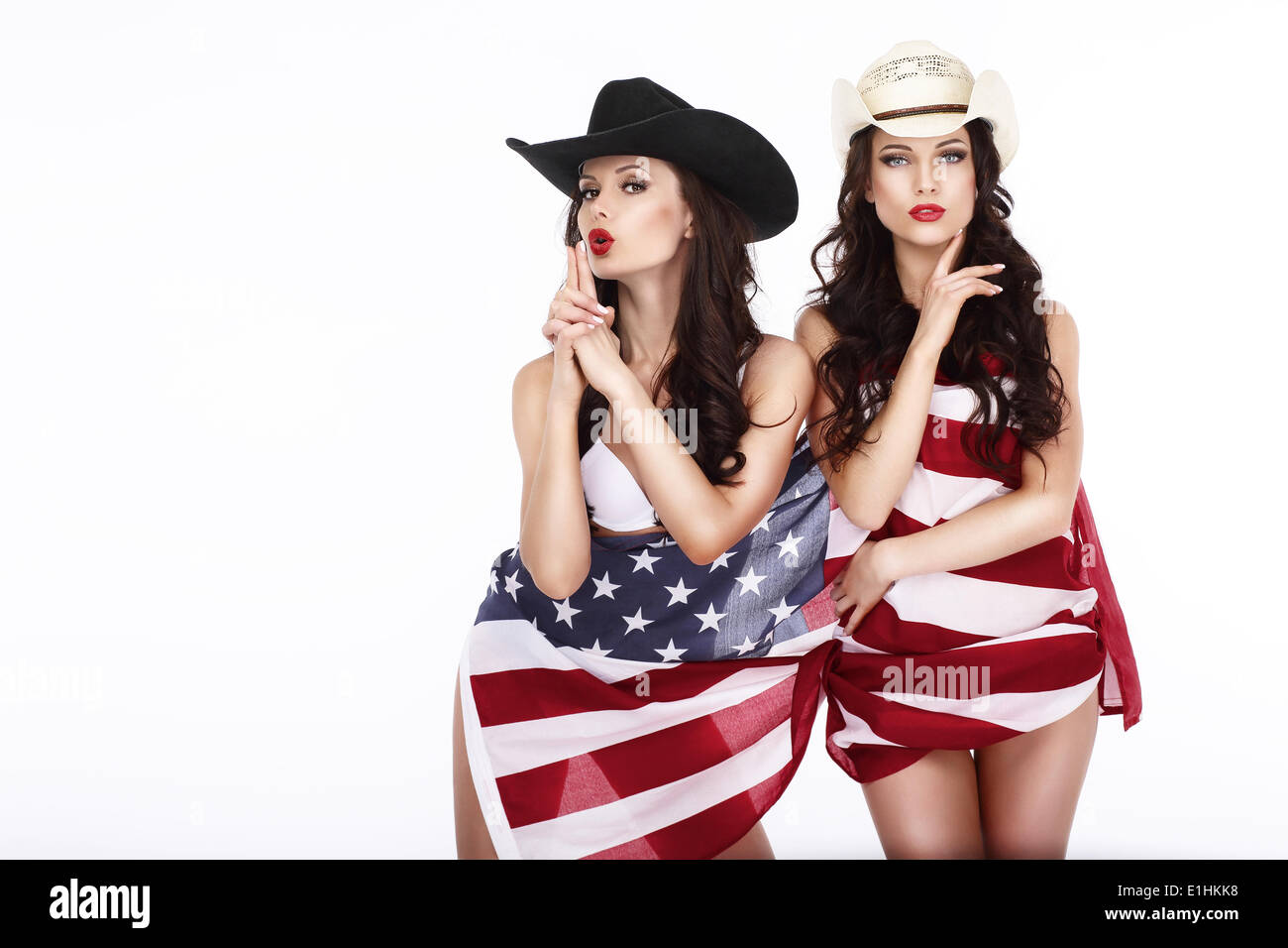 Fanciful Joyful Women Cowgirls and American Flag - Stock Image