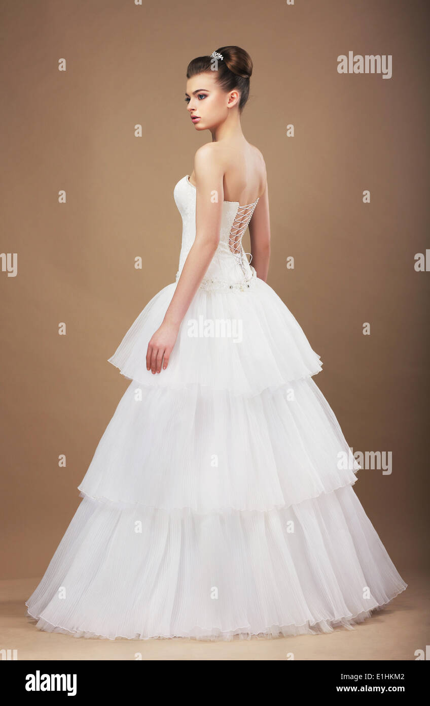 Elegance. Young Bride in Long Classic Bridal Dress - Stock Image