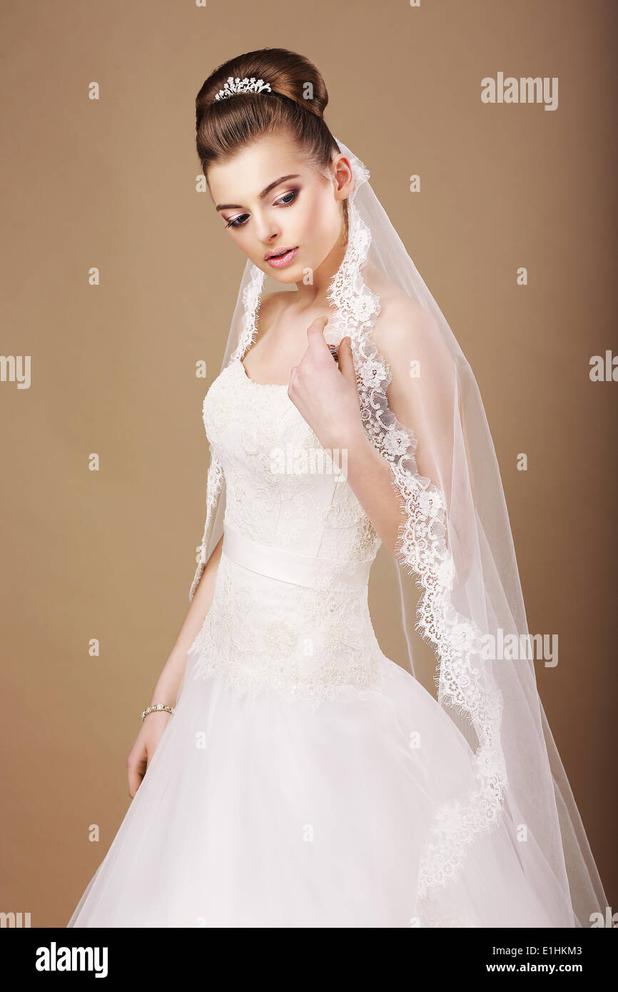 Femininity. Sentimental Bride in White Dress and Openwork Veil - Stock Image