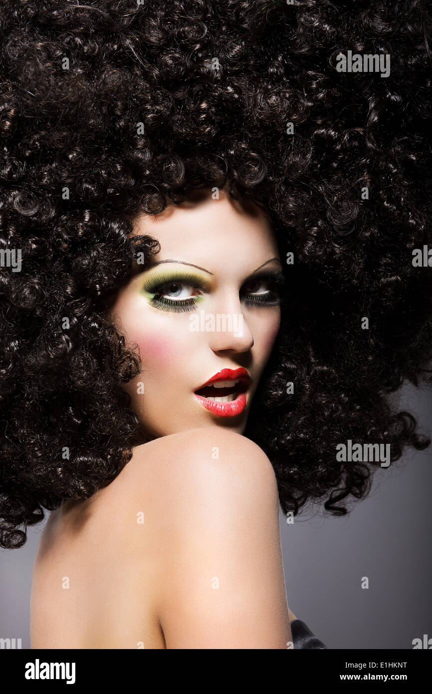 Haute Couture. Charisma. Trendy Woman with Creative Hairstyle Staring - Stock Image