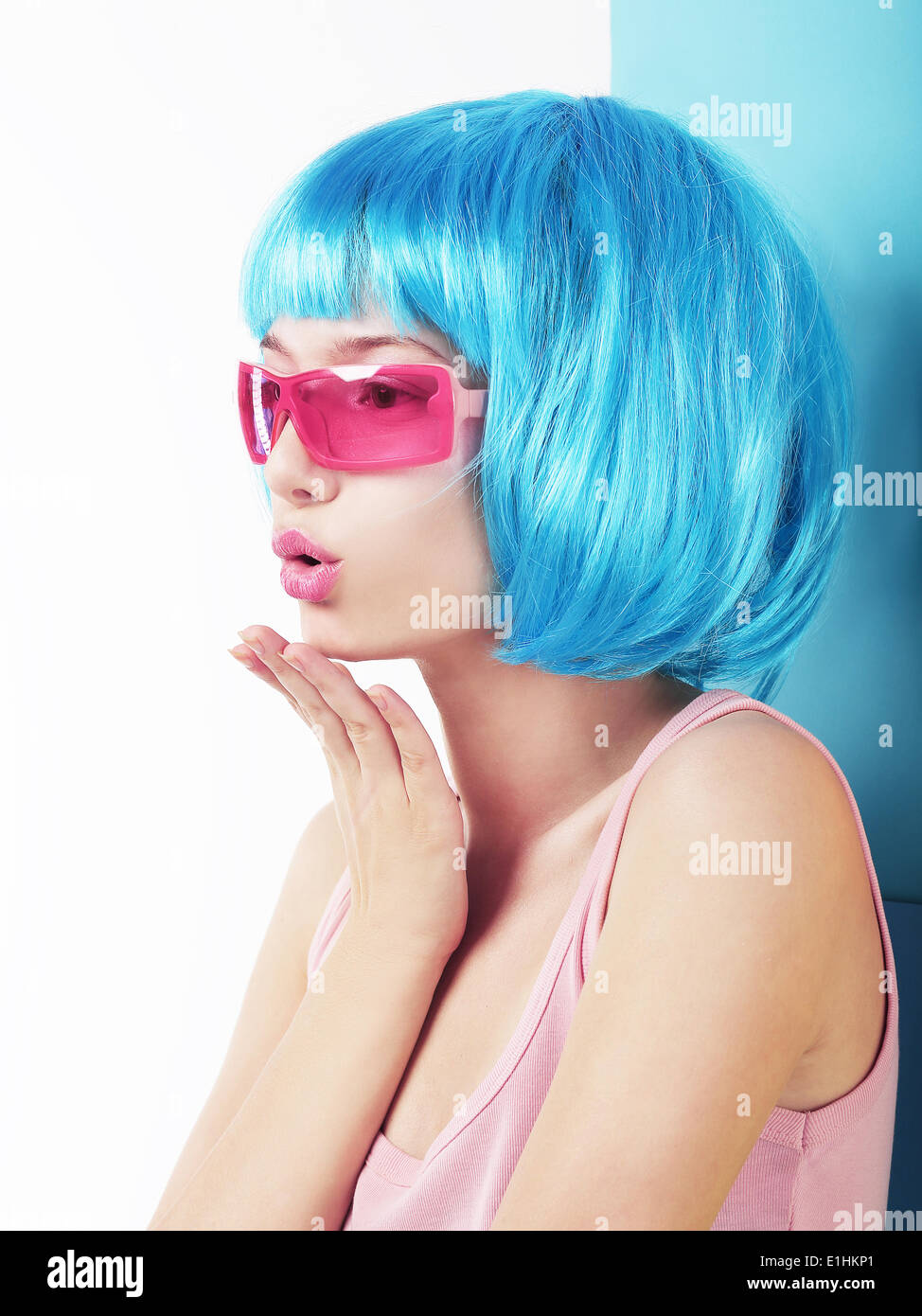 Manga Style. Profile of Charismatic Woman in Blue Wig Blowing a Kiss - Stock Image