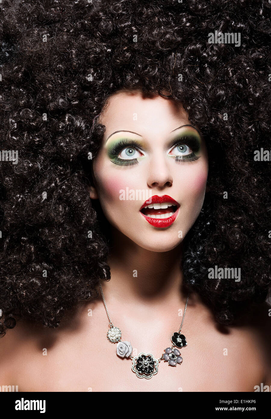 Creativity. Theatrical Emotions. Woman with Fantastic Coiffure looks like Doll - Stock Image