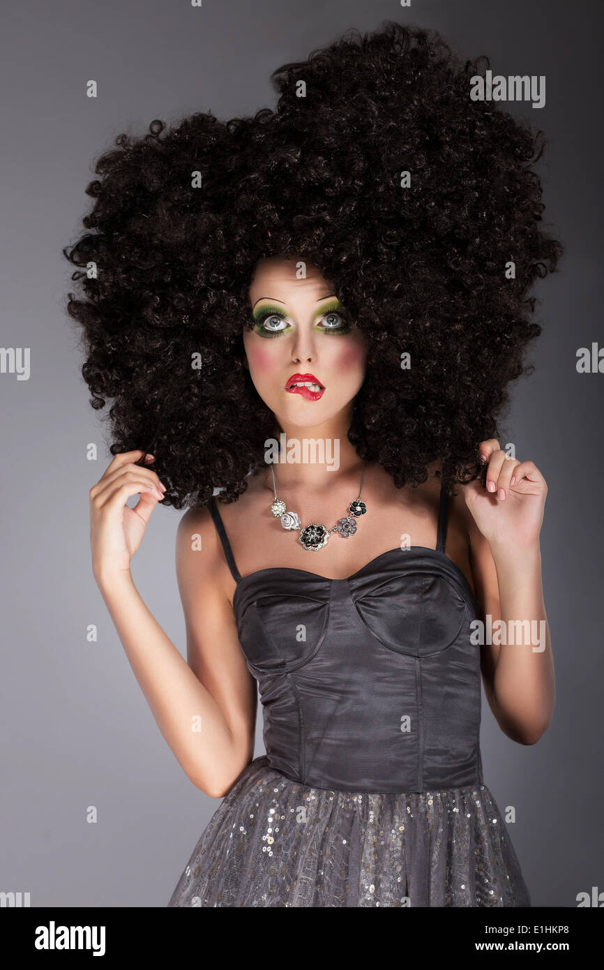 Extravagance. Eccentric Emotional Woman in Frizzy Fancy Wig with Braided Hairs - Stock Image