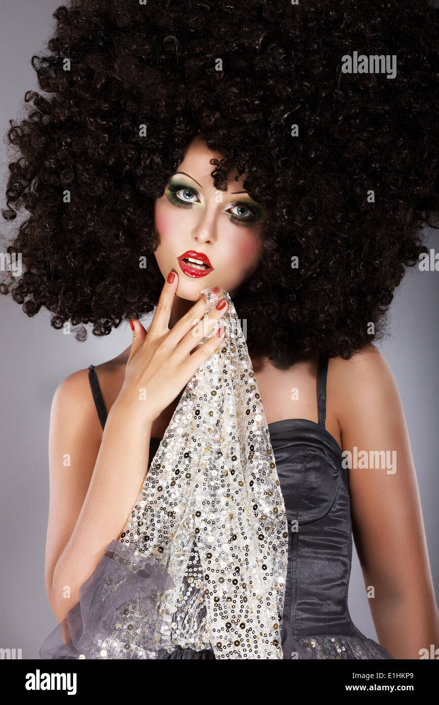 Futurism. Fanciful Girl in Huge Unusual Black African Frizzy Wig - Stock Image